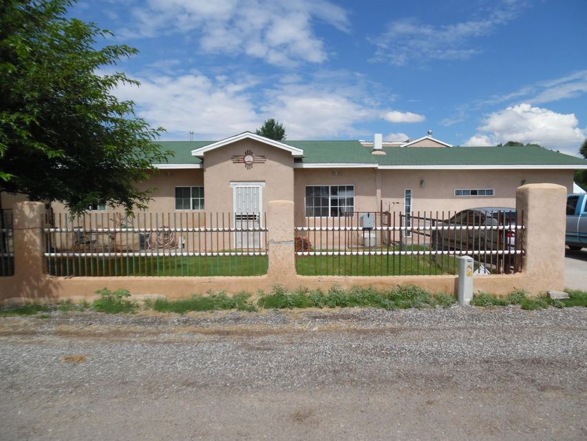 Updated, recently remodeled home  in very desirable area.  Kitchen has beautiful, solid wood cabinets and large format tile.  Bathrooms have been tastefully done with custom tile work. Home has 2 living spaces including a large ''man cave''. Master bedroom is very spacious with large closets and large master bath with separate sitting area. Property includes large 812 sq. ft RV garage for RV or vehicles. Don't miss out on this one-of-a-kind property.  Schedule your showing today!