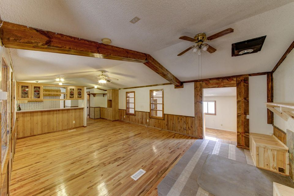 What a find!  Not just your average Los Lunas home!  This private, oversized 1.46ac property has many features.  Fully fenced perimeter, multiple garden areas with 40+ trees on property, HUGE 900 sqft 4-car garage for the workshop and toys, chicken coups, sheds, fully built well house.  On the inside, the home is remodeled with handsome wood floors and trim, newer appliances, slate tile, fresh paint.  Inspection and repairs have already been completed! Clean, private, and move in ready for its new owner!