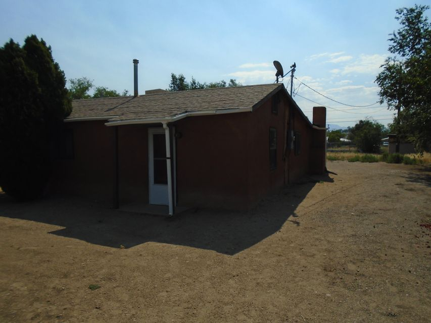 Adobe home zoned commercial on 1/4 acre. Building is in good condition and is located in an area of businesses.