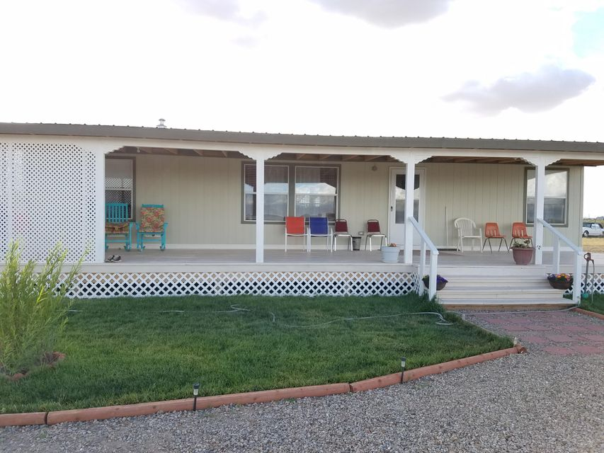 Brand New 2016 home looks like it was just built and it's move in ready. Appliances stay with the home. This well designed 3 bedroom 2 bathroom home sits on 1 acre with wonderful views of the Manzano Mountains. Spend your mornings and evenings on the large front porch in privacy. It is large enough to have lots of family and friends over for an outside fiesta. Small subdivision just off Highway 41 with less than an hour to Albuquerque or just a little over an hour to Santa Fe. Estancia is a growing community that has kept its small town feel. This is a great opportunity to live outside the big city with its high prices and the bustle of the rat race, but close enough to still work there or come out to the country and make this your retirement home. Priced to sale at a Great Value!