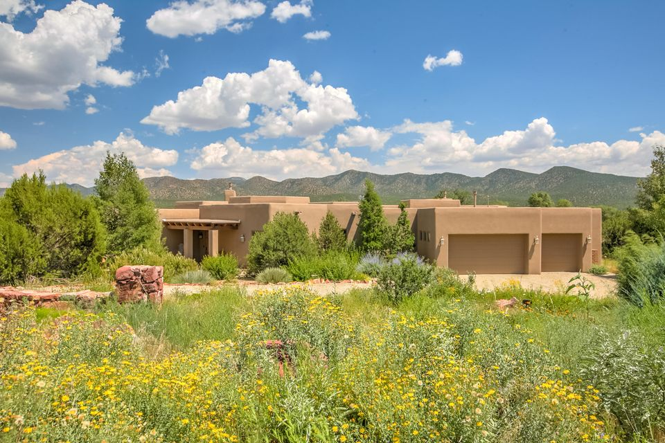 Southwest style home with beautiful mountain views, large windows and a wonderful outdoor covered living space/patio. This custom home features an office/study, with separate entrance to outdoor patio, gourmet kitchen, beautiful granite counter tops and a custom chef's cooking table/island, custom cabinets, and an open floor plan providing for a relaxed lifestyle.  Large lot with lots of privacy. See Property Brochure for complete list of Features/Amenities that this wonderful home has to offer.  Furniture and art is not included but can be negotiated as a separate purchase.  Recreational membership to Pool, Tennis and Bocce Courts is included.