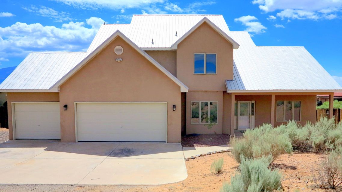 Cute Northern New Mexico style home perched on a half acre lot overlooking the Sandias.  Home features ceramic tile, three car garage, 4 bedrooms, an office, and a great metal roof.  Large master bedroom and bath with HD views of the mountains.  This home will not last long at this price!