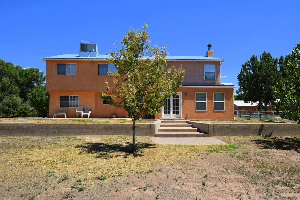 This is where the light lives! Spacious living and dining areas with gorgeous  laminate floors lead you to a remodeled kitchen. Majestic hard wood staircase takes you to the well-planned private quarters of the 2nd floor with a large Master Suite. Lovely balcony with views presents a perfect spot for watching sunrises. The large fenced in yard has fruit trees, a storage building, access to trails, and tons of privacy. Back and front patios are great for both entertaining and quiet enjoyment. This Country Idyll is ready to be Your Home!