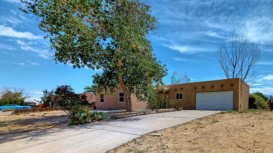 Welcome home to this updated Rio Rancho home with stunning views. Be sure to see the 3D tour. This 3 bed 2 bath single story home boasts a great open layout. Large half acre lot with plenty of room for your imagination. Newer roof, floors, windows and stucco. Updated kitchen new cabinets, countertops, and flooring. Close to highways, shopping and entertainment. See it today.