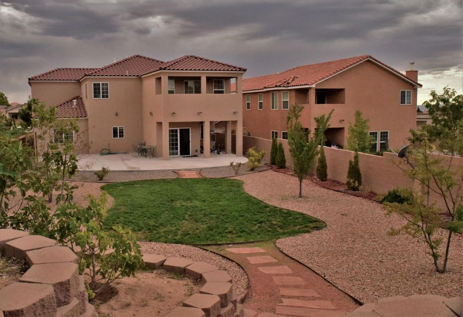 Live LARGE in a nearly NEW home on ABQ's Eastside w/3500 sqft & one of BIGGEST lots in Volterra! Master Planned VOLTERRA community with NO PID Taxes on this home!! That's Right! Save $$$Thousands over competition w/out the PID, year after year!!! A SMART design w/5bed/3bath, loft, HUGE family room & breakfast room open to GOURMET kitchen, plus formal living & dining! A GRAND Master Suite greets you w/French doors upstairs & features a covered balcony, spa bath, separate shower & large walk-in closet! Xtra Storage! 3 Car Garage! Build GreenNM w/Energy Efficient Features= more $$$Savings! GE Profile Appliances! Crystal Chandeliers! Extended Patio! $45k in Landscaping! 2x6 Framed! Low Gas/Elec! Across from Open Space! Unbeatable Bkyard! POSSIBLE REC w/10-15%+DOWN @ 1% ABOVE MKT, 3-5yrs MAX!!