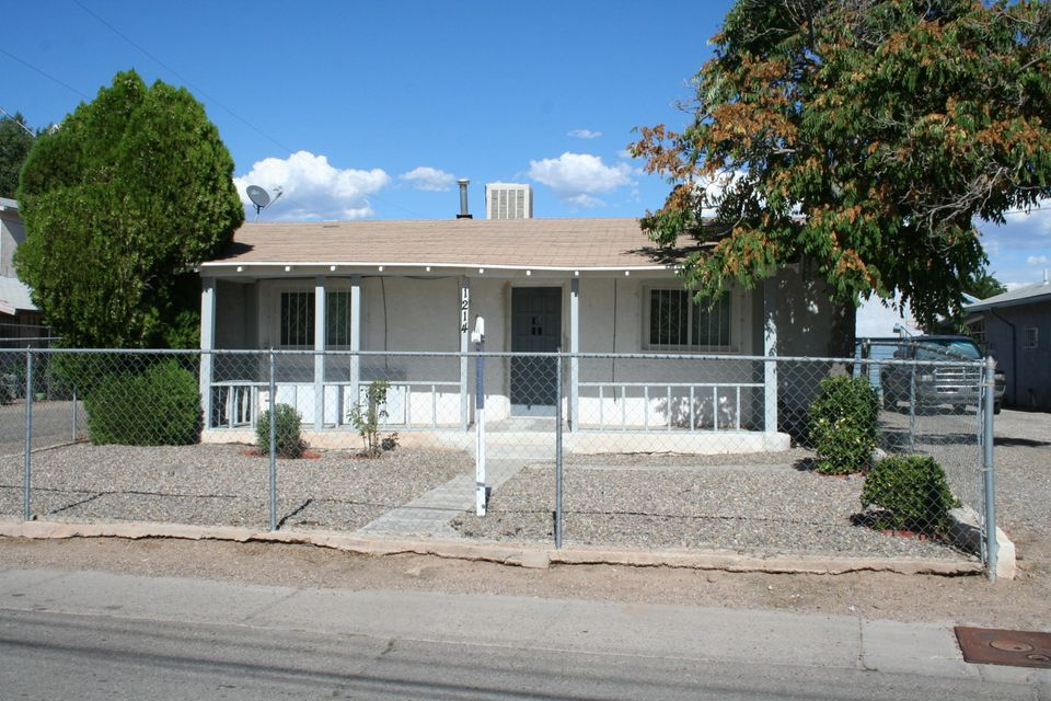 This gorgeous adobe in historic Duranes neighborhood is the perfect retreat near the heart of Downtown. You are minutes away from afternoon strolls in Old Town, or mornings at the Railyards - surrounded by art galleries, local restaurants, and easy access to the Rapid Transit. Come home to original wood floors, fresh paint, and bright natural light from windows updated in 2015. A large eat-in kitchen features the original handmade cabinets, and a generous laundry rm has extra storage space. The bonus room off the master bedroom can be used as a third bedroom, office, home gym, or studio. The large front porch is perfect for relaxing year-round and watching the sunset, and the fenced backyard has access for off-street parking, a 12'x20' metal carport, and a secure 14x10 Morgan storage shed.