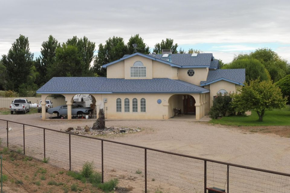 Beautiful, Custom, 4 Bdrm., 3 Bath, home in Peralta, NM. This home has a large spacious kitchen with lots of cabinet space, island and bar, electric cook top, built in oven. Relax in the main living area with a cozy pellet stove. Also a formal dining area and formal living room for entertaining.  Also downstairs is a spacious office or could be a fifth bedroom. Upstairs is a cozy loft, and four spacious bedrooms. Master suite has its own balcony and a large full bath with garden tub, and custom shower, his and hers vanities, huge walk in closet. Nice 3 car garage and car port. Relax outside with plenty of shady trees and green lawn. This home sits on a one acre lot, so bring your farm animals, or plenty of room for gardening.