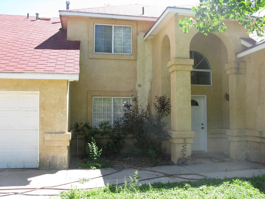 This home needs to be shined up a little but lots of potential here! Very secluded location close to the bosque. Two living areas. Pellet stove insert. Sky-lights. Master Bedroom downstairs  two bedrooms and a study or possible fourth bedroom upstairs. Three car garage! Storage building does not convey.