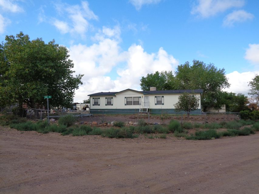 Spacious 4 bedroom, 2 bath double-wide on .50 acre parcel.  Huge country kitchen, large living room, split master suite and large covered patio.  This includes two .25 acre parcels fenced and cross-fenced.  Animal pens.  Above ground pool. Additional lot UPC# 1013035147400000000. Seller will consider financing.