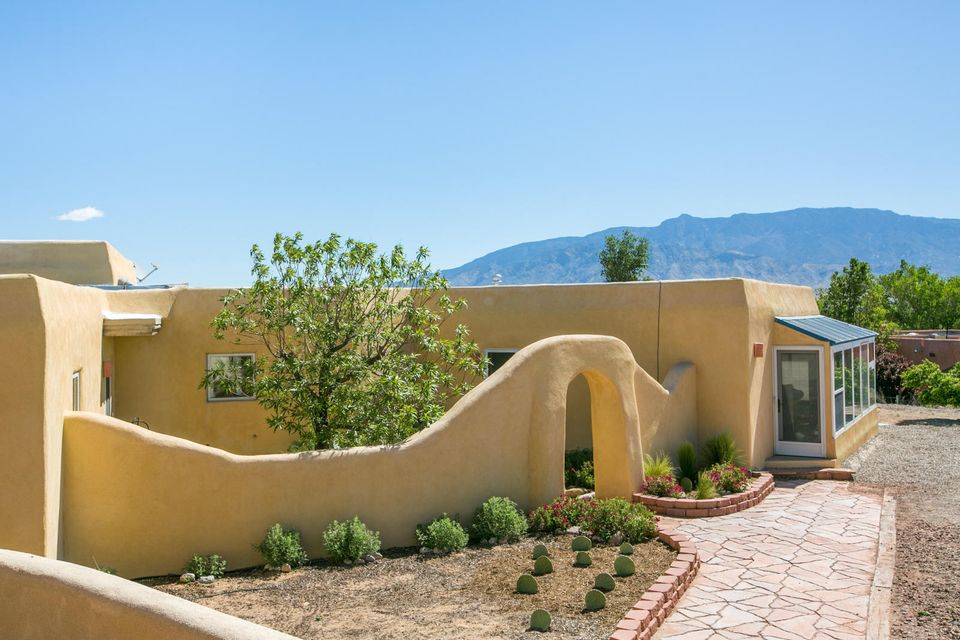 PRICED TO SELL! This Enchanting Corrales Compound Offers Some of the Best Sandia Mountain and City Light Views in the Village! Classic Corrales Charm; Partial Adobe Construction, Beam Ceilings, 2 Kiva FPs, Brick Floors PLUS Over 3000sqft of Detailed Upgrades! New Refrigerated Air/Heating System w/ Built In Humidifier, New Electrical Panel, New Water Filter, New Wood Flooring, Upgraded Windows and Window Coverings, Tastefully Updated Kitchen and Baths. A 1352sqft Heated and Cooled Artist's Studio/Workshop w/ 2 Car Garage Crowns the Property and Frames the Breathtaking Views. A Perfect Space for an Artist, Craftsman or Mechanic to Create in a Gorgeous Setting. Detached, Cooled, Oversized 2 Car Garage Sits Adjacent to the Main Home. Gorgeous Grounds and Gardens Surround.