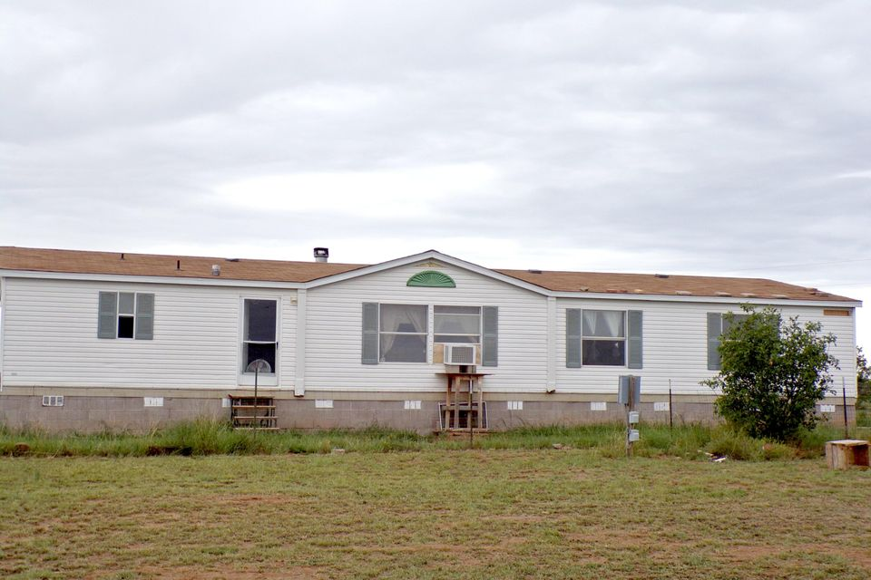 This manufractured home was built in 2000 and resides on 5 acres between Moriarty and Edgewood, New Mexico, making this your easy commute to either Albuquerque or Santa Fe. Great affordable starter home with a country lifestyle. This home has 3 bedrooms and 2 baths with an office area that could be a fourth bedroom for a total of 1960 square feet. This home can be financed as a conventional loan with My Bank.