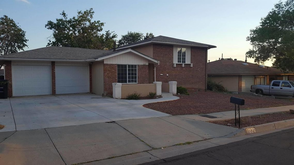 Beautiful 4BED, 2BA, 2Car Garage Far North East Heights home with a nice open kitchen. 2+ Living rooms, 3 rooms in upper level and Master room in Lower level. Close to shoppings and schools. Come check it out today!