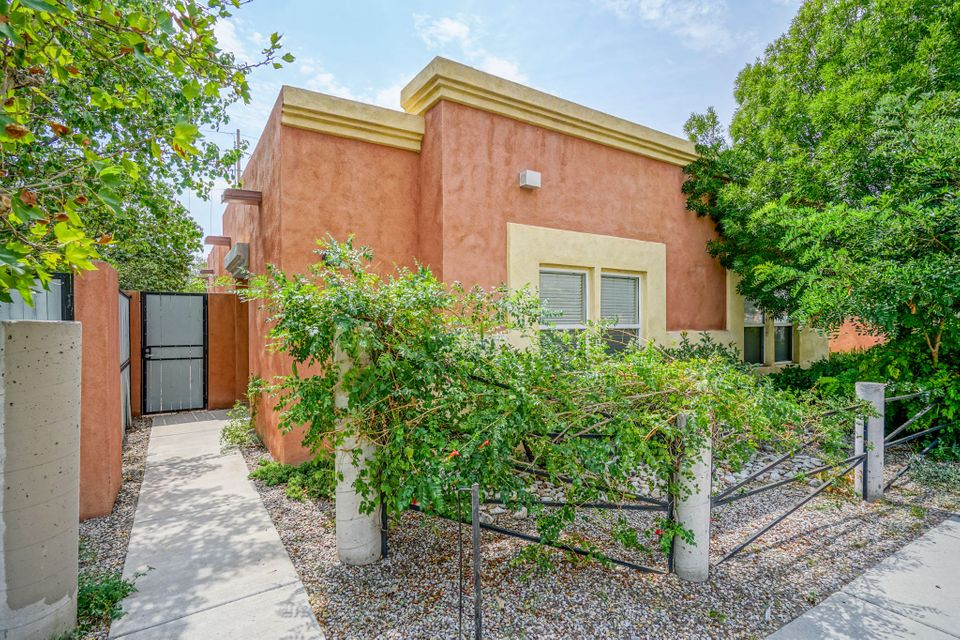 You will love this Downtown home! Custom construction, 9 Ft. Ceilings, Radiant heat, Stained concrete floors, Skylights, French doors and a 2 CAR GARAGE!  Beautiful Xeriscaping and private patio. Minutes from UNM, and Kirtland Air Force Base.
