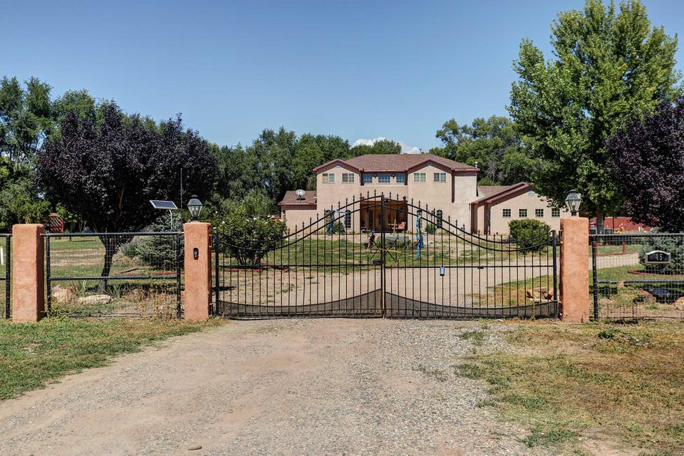 Welcome to this one of a kind Custom Build. This Tucked away Oasis is Located on 2.2 Acres of usable land. The Property is fully fenced including a breath taking gate as you enter. The inside of the home shows pride of ownership. Custom Wood Floors Throughout the House. Upgraded Backsplash and Stainless Steel Appliances Complete the Beautiful Kitchen. Some other Great features  this home offers are a 3 Car garage, Upgraded bathrooms, Walk In Pantry, and Radiant Heat! Come make this your own personal paradise.