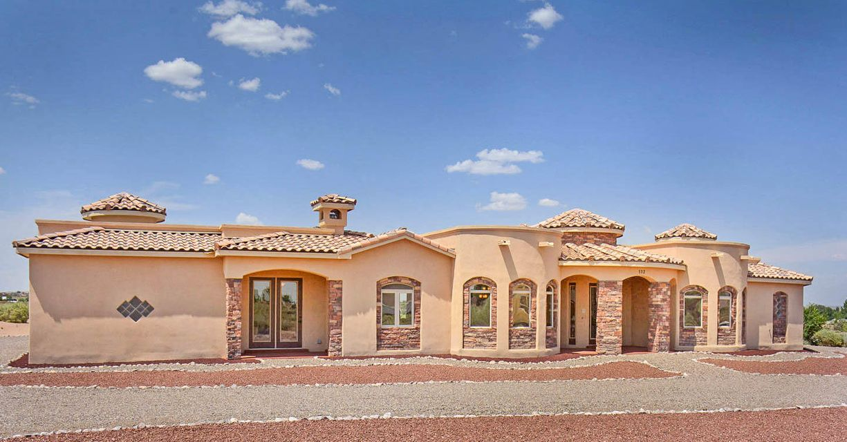 Stunning 4 bedroom 4 bath on 1.06 acres in Corrales. Be sure to see the 3D tour! Custom built in 2009 with countless thoughtful touches. Majestic Sandia Views! Living room boasts cozy kiva fireplace. Centerpiece gourmet kitchen boasts granite, stainless steel and top of the line appliances. Master bedroom retreat with spacious copper bathroom. Art collectors dream with niches for all your treasures. Huge garage with storage room and R.V. parking. Smart home ready. Stay comfortable with 2 heat a/c combo units, 9 Zone in-floor radiant heat and instant hot water. Yard is ready for your imagination with gas stub for bbq grill and pre-plumbed for sprinklers. Inspections on file. See it and fall in love.