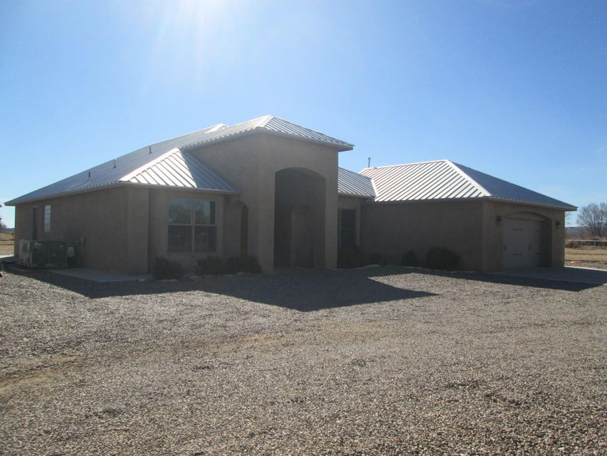 Gorgeous custom one-of-a-kind home on over 4.6 acres (house on 1.68 acres MLS #902711) of farm land located in the heart of the Bosque. 1-owner home located on the green belt of the valley.  Home features beautiful open floor plan with soaring 12 ft beam ceilings, kiva fireplace and custom wood and tile flooring. The chef's kitchen features granite countertops, breakfast bar, pantry, custom cabinets, 2 ovens and high-end stainless steel appliances. The Master Suite has kiva fireplace, very spacious walk-in shower and a huge closet. Pipe fenced, asphalt driveway, rock landscaping, fruit trees & native cottonwood trees and K31 grass pasture.  Irrigation rights, ADA capable. Come to the country, bring your toys, your animals, your family & your dreams!  Build another home on 2.92 acres!
