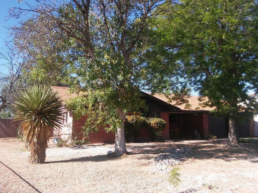 Affordable Corrales property that's close to everything, ready for you to make it your own. This is an estate and being sold as-is. Need room for horses? It's here. Need back yard access? It's here as it's a corner lot. Come see the opportunity and potential with this full Brick home on almost a half acre. This home is one of only a few in Corrales that has City Water and City Sewer. The back yard could work in many ways. The existing structures could be 6 horse stalls. The garage has a heater in it, so great workshop or hobby space potential. Call today to see it!