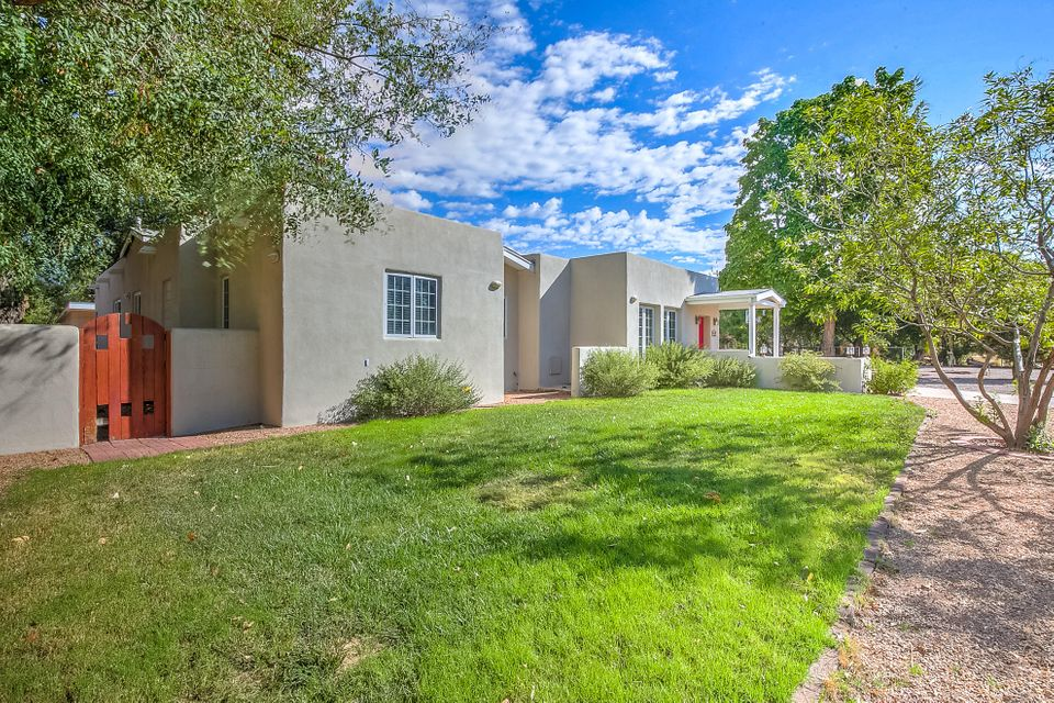 Must see! Updated beautiful home on half an acre w/Casita. Kitchen has new granite counters, back splash, gas cooktop, double oven,and newer appliances w/ large pantry. New carpet,blinds,light fixtures & fresh paint.Finishes include stained concrete floors, Italian tile, diamond plaster finish on fireplace, Kolbe & Kolbe windows & exterior doors and custom trim  throughout+Refrigerated air.Casita has been updated, w/carpet,paint, light fixtures, bathroom & kitchen has granite counter coming soon.Washer/dryer  included.  Oversized 2 car heated garage.Backyard access. Huge storage/workshop in the backyard. Close to downtown,Old Town, freeways and Paseo del Bosque Trail.Casita is included in the square footage. New irrigation well!