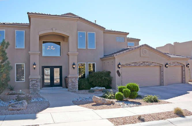 **OPEN HOUSE SUNDAY 22nd from 1:00-4:00** Custom home in highly desired Quivera Estates gated community. This home is LOADED with upscale features and offers an open/versatile floor plan. Two master bedrooms and a possible main floor bedroom with existing 3/4 bathroom. Two laundry facilities allows the main floor area to be used as an office/hobby room/butler pantry/pet area with access to the backyard. 990 square foot garage is fully insulated and has a workshop area and storage closet. Private backyard with room for future pool, hot tub, play structure, etc. Home shows GREAT! Owner may consider trade option for smaller home.