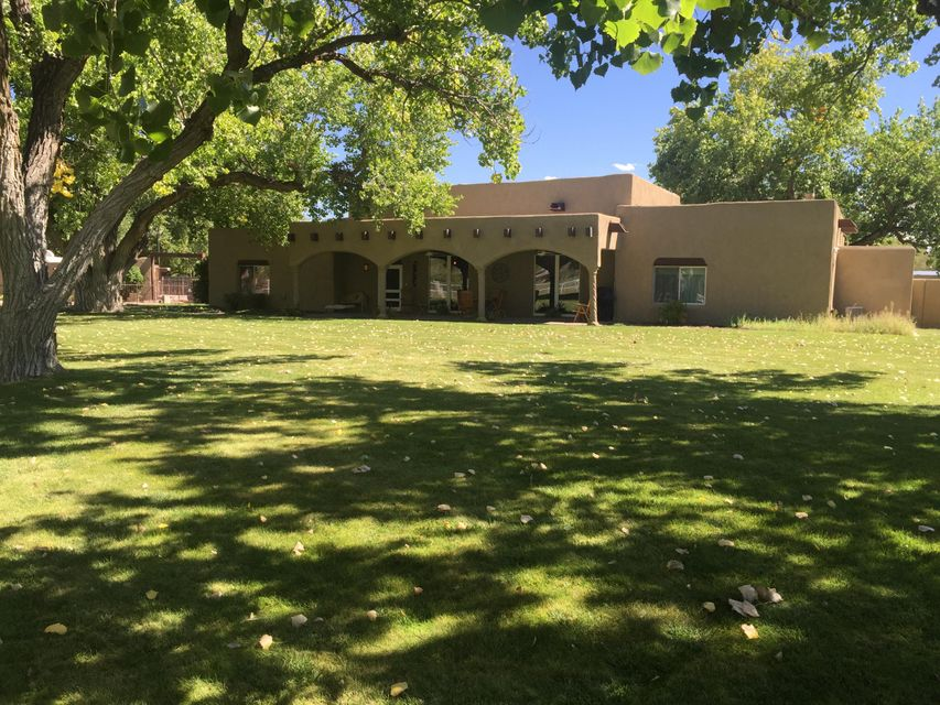 Structures include 3,820 sf main house, 879 sf guest house and 938 sf office/studio. Non heated areas include a 275 sf garage and 1000 sf 4 stall horse barn with run outs.
