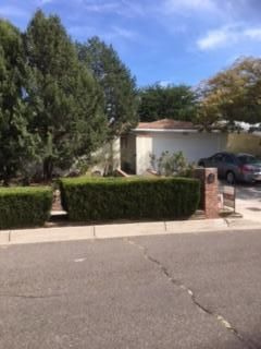 Exceptional value for this outstanding NE Heights home. Not a ''cookie cutter'' ranch house, this one stands out in this neighborhood. Privacy wall encloses a front patio which has a built in grill. New windows, new stucco, freshly painted throughout. Back porch with terraced back yard surrounded by a high wall.Lots of cabinets in the tiled kitchen and a roomy dining area. Big master bedroom with glass display shelves-cozy fireplace in large living room.Extra large garage with built in storage.