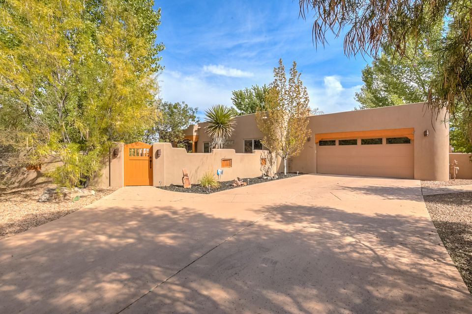 Stunning Custom One Story Home in the Picturesque Bosque Encantado Gated Community! Ideally located at the end of a Cul-De-Sac with beautiful Bosque and Mountain Views! Enter through the spacious Courtyard! This Northern NM Style Home has 2481 Sq Ft, Nice Open Floorplan with 3 BRs, Office or 4th BR,  20'' tile throughout with the exception of the Office which has Engineered Wood flooring, Radiant Heat with 8 Zones, Pella Windows and Doors, Solid Wood Interior Doors, Large Great Room with beautiful Kiva FP, Vigas, Corbels and Hand Carved Latillas at ceiling above DR, Large Master Suite has a Steam Shower, Two Way Gas Fireplace, Door to the Back Patio, Huge Master Closet. Kitchen has Granite Countertops, Gas Cooktop, Large beautiful Vent Hood, Wine Frige, LG Pantry, Skylights, see MORE....