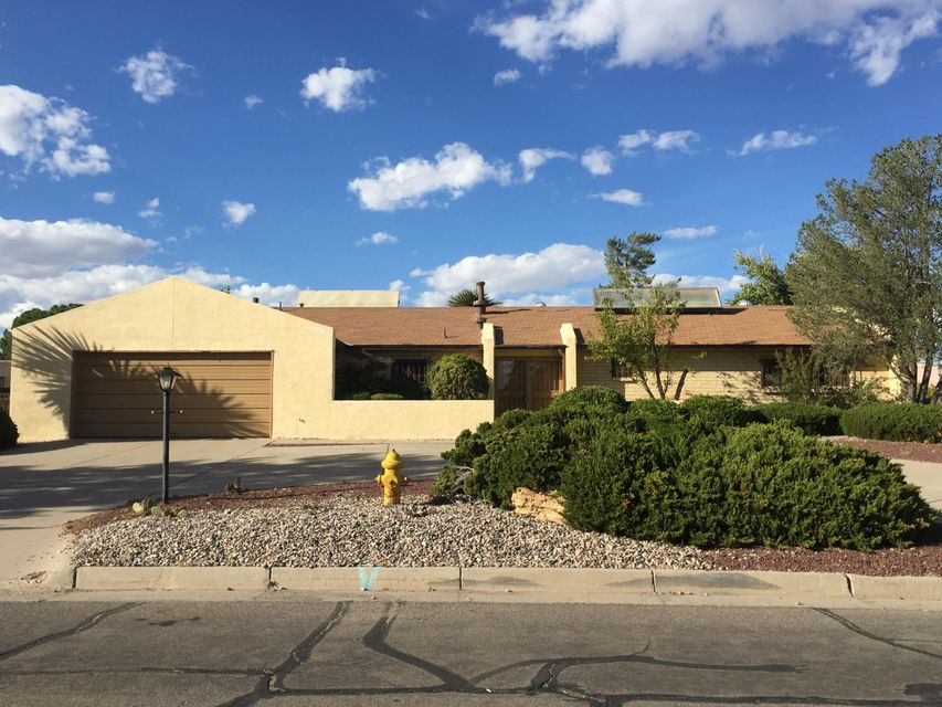 Spacious Home centrally located in Rio Rancho. Circular dive way.  Double door entry.  Two large living areas, one with  a fireplace. Three Large bedrooms. On a .29 lot. Home has good bones. A great place to call home. being sold as is.