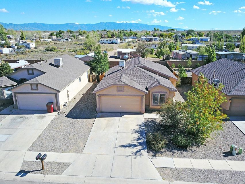Come see this great home with an open floor plan that includes 3 bedrooms, 2 bathrooms, and a 2 car garage. The front yard is landscaped with a drip system for easy maintenance.  The backyard & patio are great for BBQ's or just relaxing in the warm NM sun.