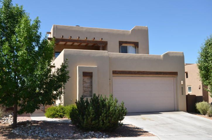 This home is in the desirable gated community of Desert Ridge. Soaring ceilings and many windows offer a bright interior. Large kitchen, abundance of counter space. A powder room, master bedroom and laundry room conveniently on first floor. Second floor has a spacious landing, with three additional bedrooms, two baths and an outdoor covered patio with beautiful views. Property is walled with a back covered patio and low maintenance yard. In La Cueva school district area, convenient to shopping and restaurants in the wonderful Paseo del Norte area.
