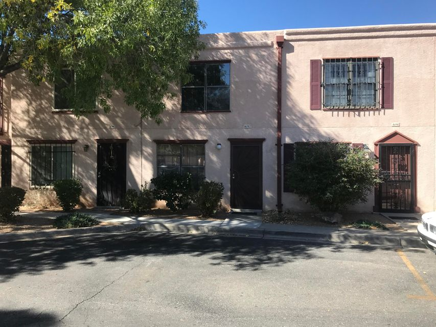 Great Condo location in Uptown Albuquerque. Ideal for UNM or CNM students. Great Room on 1st floor has wood burning fireplace. Kitchen, Dining Area and Utility Closet also on 1st floor. Sliding Doors in Dining Area lead to the private patio with attached storage room. From Patio exit to unit carport. Two Master Suites are upstairs with large closets and carpeting.