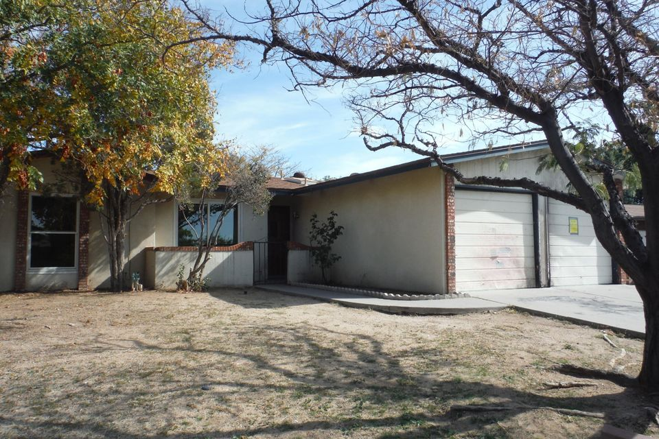 Great opportunity in the NE Heights, four bedroom two bath home with an open floor plan on a corner lot! Close to parks, trails and shopping.