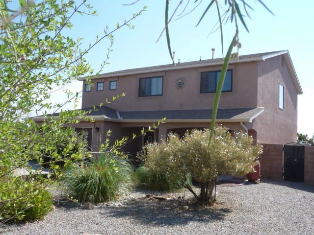 Very motivated sellers say ''bring all offers!'' Wonderful large home with amazing VIEWS! 4BR + loft, + 2 living areas! Refrigerated air (2015); water heater (2016); SS refrigerator, stove & microwave (2016);Anderson windows throughout upstairs (2016) & several new windows downstairs (2017); new vanity in half bath! And there's more! Alarm system & ceiling fans throughout, + upgraded laminate floors in living room. Great master suite with garden tub, sep. shower, dbl sinks, walk-in closet. Outside? Lovely landscaping front & back, auto sprinklers/bubblers, plus both covered & open patios, seamless gutters, solar lights & security lights, custom wrought iron gates for RV access, & generous RV parking. Beyond the block wall is more yard-- full 1/2 acre lot, with storage shed on eastern porti