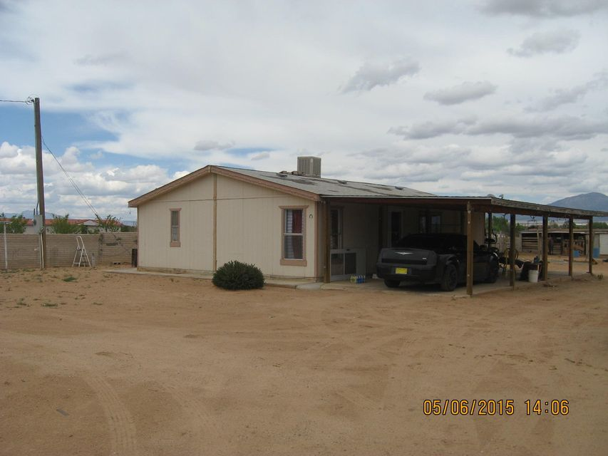Nice doublewide with room for horses and a nice concrete wall around the entire lot. Home set down at ground level. Come out to the country on a large lot and enjoy the mountain views. Corral and fencing in place on the lot. Right off El Cerro Mission Blvd. so no dirt roads to deal with. Nice large 2-car carport and two storage buildings. Come take a look today.
