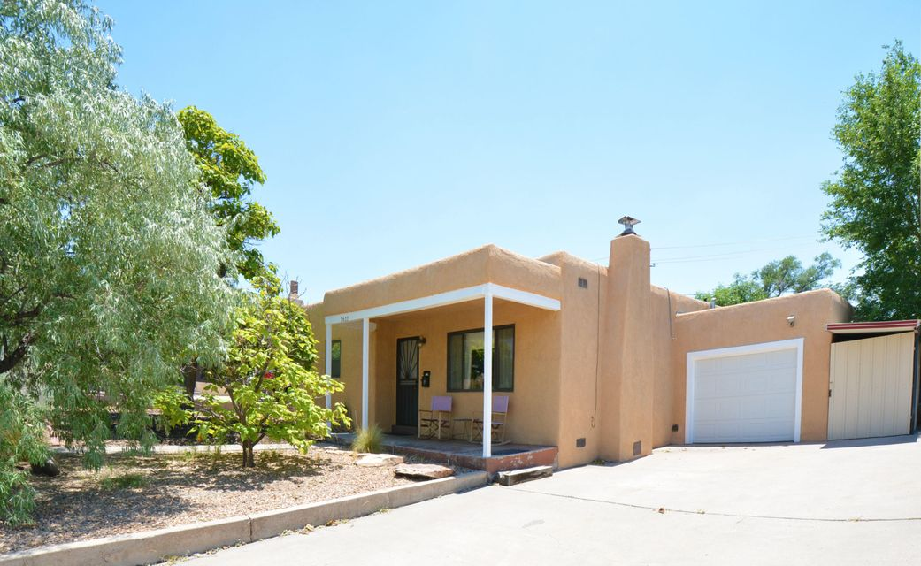 Clean Open Move-in Ready UNM AREA home with a BRAND NEW (June 2017) Heating / Refrigerated air combo unit for those hot Albuquerque summer days. 3 bedrooms, 1.75 baths, a family room, plus an extra long attached garage. Open floor plan with carved wooden beamed archway between kitchen and living room. Wood burning fireplace insert with glass doors in Living room. Sola-tube skylight in spacious kitchen. Hardwood, cork, and ceramic tile floors through-out. NO carpet. Generous closet space in each bedroom. Ceiling fans in all bedrooms. Lush private backyard with storage shed complete with electricity. All major appliances convey with home. Extra deep driveway for those extra cars. Close to the sports stadium, Puerta del Sol Golf Course, and bus lines.