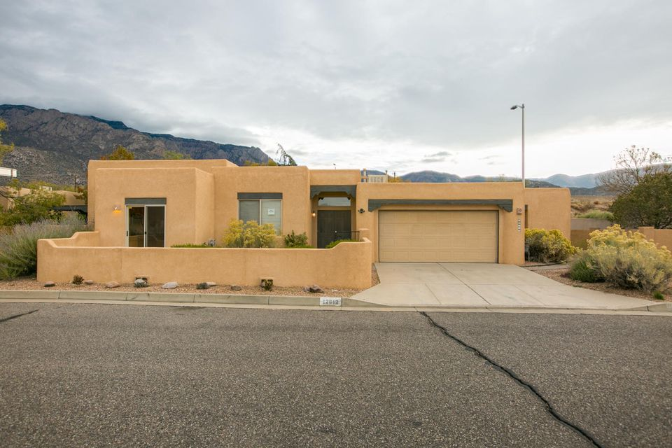 santa fe charm is what you will find in this beautiful home with great view of