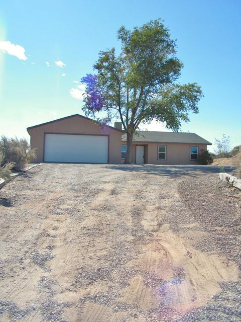 Updated single story home on 1/2 acre lot. Two living areas, fresh paint, new fixtures, doors and windows. Master bedroom has walk in closet and stand up shower. Bedrooms have new carpet. Both bathrooms are updated with surround tile, new vanities. Detached 2 car garage and lots of parking.