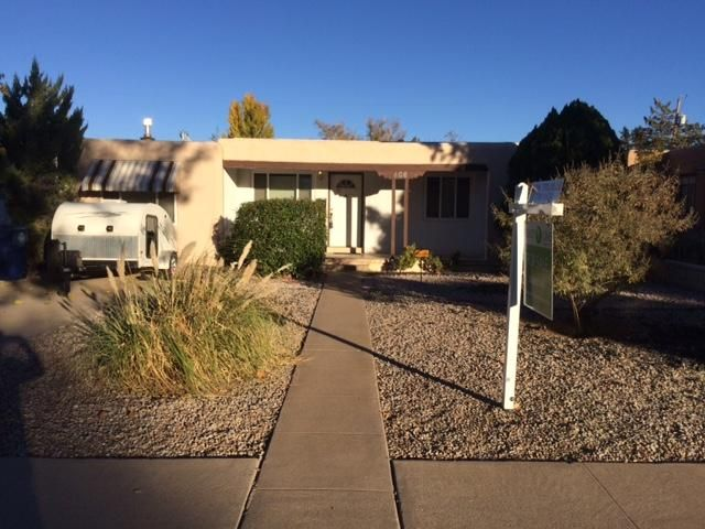 Beautiful well maintained Home in UNM area. Furnace and A/C installed in 2007. Roof maintenanced 2017. Hardwood Floors, Tiled in all wet areas, granite counter tops, Alarm, Ample closets, Garage converted into living space, covered patio, tuff shed, water barrel, upgraded electrical, Dbl-pane windows, Landscaped front & back, Backyard access. Owner occupied; PLEASE schedule via Showingtime. Have opened Title with Debbie Talley at Fidelity Title.