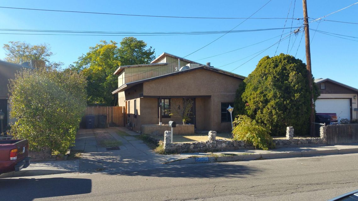 North Valley gem.  Hard to find this sq ft in this party of town. BARGAIN! With a little work, this could be a beauty.  Sweat equity here we come.  Great value, over 1500 sqft.  2 bedrooms and one bath upstairs, and one bedroom and bath on main level.  Convenient location near downtown, I-25 and I-40.