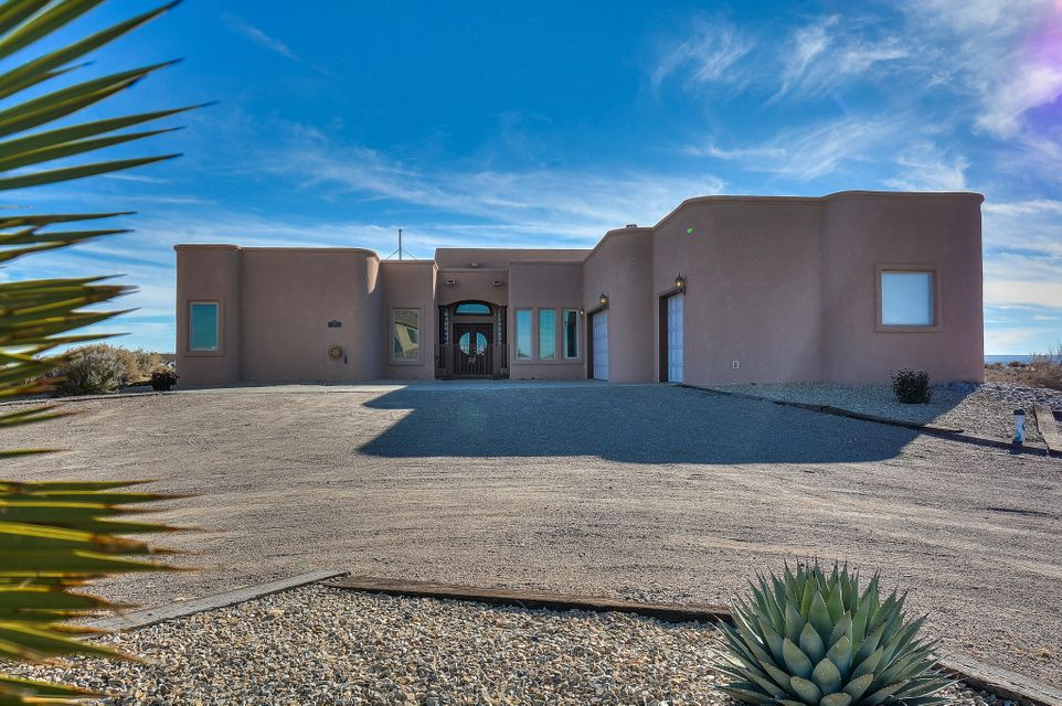 Stunning Cordova Custom Home located on a large 1/2 acre lot in the heart of Rio Rancho! This spacious home features 4,317 sf w/ 5 bedrooms, 4 baths, 2 living areas, an office and a 3-car garage! Gourmet kitchen w/ high-end cabs/crown molding, granite countertops, built-in double oven, microwave, cooktop, LG Fridge, center prep island, pantry & built-in desk/mail area! Gorgeous main living area w/ raised coffered ceilings, hardwood flooring & an amazing fireplace! JR suite w/ private bath. Beautiful master suite w/ hardwood flooring, a romantic 2-way fireplace, outdoor access w/ patio & a spa-like bath! Bath hosts his/hes sink w/ custom vanities, large jetted tub w/ mountain views, walk-in shower & private dressing area! Deck w/ hot tub overlooking the Sandia Mountains! This is a must see!