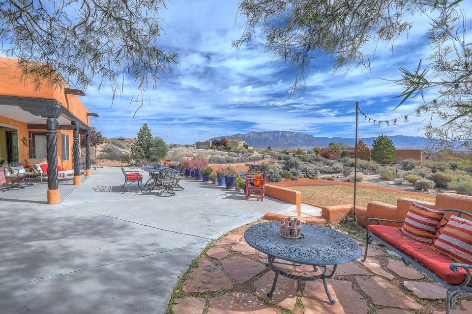Million dollar view! Fantastic home perfectly situated to  showcase mountain and city views. Private gated property with lots of character & charm. Gourmet kitchen which is literally the heart of this home, 2 living spaces, dining room and master retreat is separated from rest of bedrooms for privacy.Solid pine cabinets & doors, saltillo tile, ss appliances with silestone counters, tongue and groove ceiling with vigas, exposed adobe accent walls. Zoned Radiant heat, plaster fireplace &accent wall, picture windows from living area solar entry gate, walk in closets in all bedrooms. Automatic sprinkler & drip system.Private courtyard entry ,  unbelievable patio for watching sunrise/sunset and perfect entertaining space. This amazing home has so much to offer!