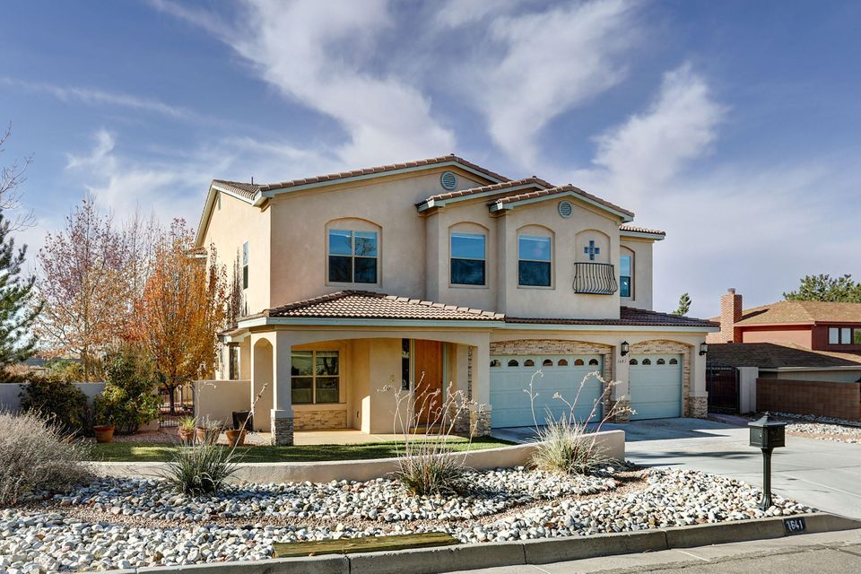 This stunning home rests on a .34 cul-de-sac, professionally landscaped lot. 360 views offer city & mountain scapes. Masterly built just 9 yrs. ago this home has cheerful natural light while enjoying a very open floorplan w/ 3 optional living spaces. Den w/stacked stone FP. Large kitchen w/stainless appliances, engineered hard wood floors, hard surface countertops & tons of  custom cabinets will make any chef smile. Featuring 2 master suites each with their own master bath & master walk in closet. This could serve a multigenerational family quite well with 2 laundry rooms too.  Down master enjoys its own private courtyard & ability for a roll in shower as well as wide doorways. Upstairs master has a fabulous view deck, cozy 2 way FP to be shared by bath. Generous room sizes throughout.