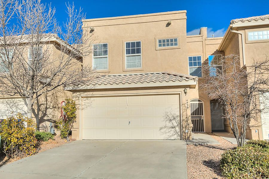 Wonderful Amberglen Subdivision in the Northeast Heights! Spacious, Updated 2 Story Townhome by Fuller on a Private, Cul-de-sac lot w/views of the Sandia Mountains & City Lights! Private, secure air-lock entry; Updated interior w/three spacious bedrooms; private master w/Pergo type flooring, city view windows, big walk-in closet & private bath. Three baths (two up & one down), spacious greatroom w/Pergo type flooring & outdoor/bkyd access, country kitchen w/light wood cabinetry, ceramic tile flooring, contemporary task lighting & pendant lighting, dining area w/ceramic tile flooring & view windows, service room w/storage & garage access, 2 car garage w/workshop space. Private bkyd w/easy maintenance. Recent re-paint 4/ 2018, some recent re-carpet 4/2018. A Must See!