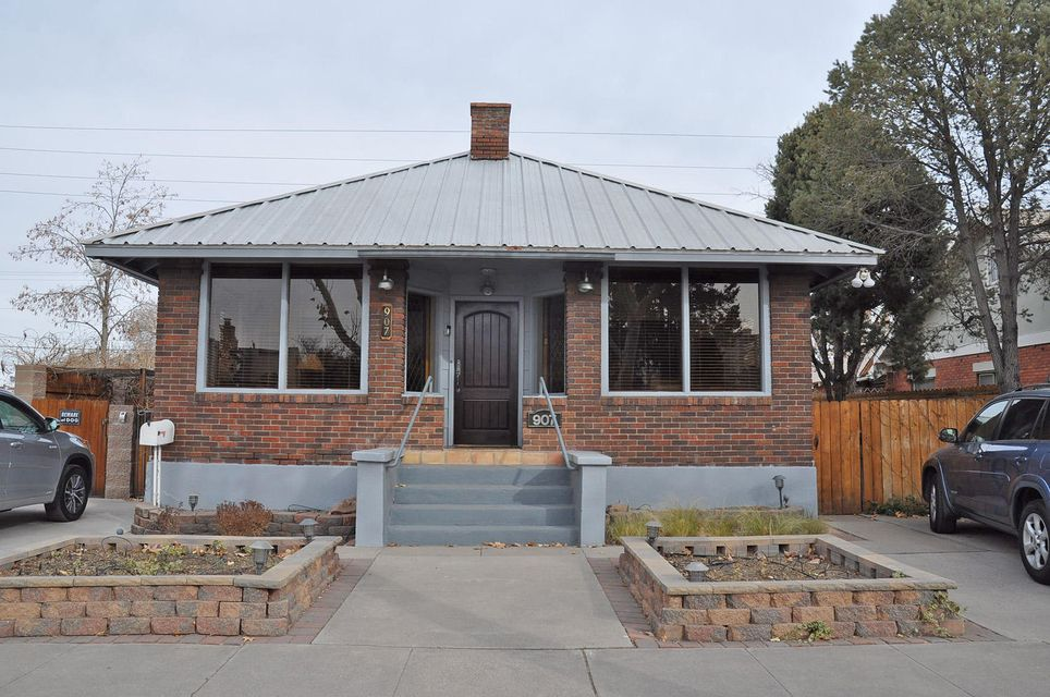 Historic Bungalow 2 story + 3 rental units in the heart of Downtown ABQ 2120/SF 2 story home main level sunny entry, open living-dining-fireplace, dream kitchen has updated stainless appliances, gas range, oven, French door fridge, DW custom cabinets, granite countertops double-sided breakfast bar 1st Floor master w/full bath! Interior & exterior basement access 2nd story has a master BD & BA + deck & 3rd/BD or office Bsmt has office & two additional rooms. 1/BD apt attached to house + 2 darling detached apts at rear of the property lower 1/BD apt 1/BD 2nd story apt w/views of the Downtown Skyline Plus a detached studio & 1/CG Each apt has 1 parking space they access inside the remote-controlled security gate & access to W/D pay machines in a tenant laundry room. Beautiful Garden space too