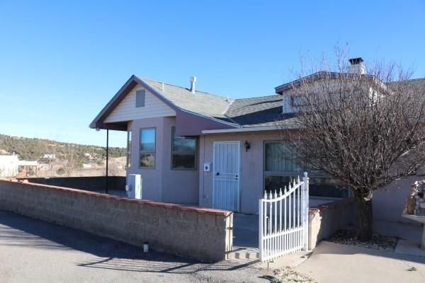 Custom built home located on 2.5 acres with views of the mountains.  The kitchen is spacious and has plenty of counter space.  Family room has a wood burning fireplace.  The master suite is huge and has great light.  There are 2 additional rooms that are nice sized.  This is a great property.