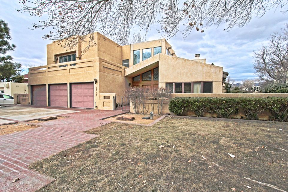 Located in the beautiful gated Tanoan West Community, this .34 acre corner lot property backs up to the golf course.  Amenities include triple master suites, entertainment room, two comfortable living areas, dining room, breakfast nook, wet bar, three fireplaces, sizable kitchen, solid oak custom front door, recessed lighting, ample storage space, an entertainers dream backyard with an extended deck, covered patio, built in hot tub and pool. This is the best value in Tanoan!
