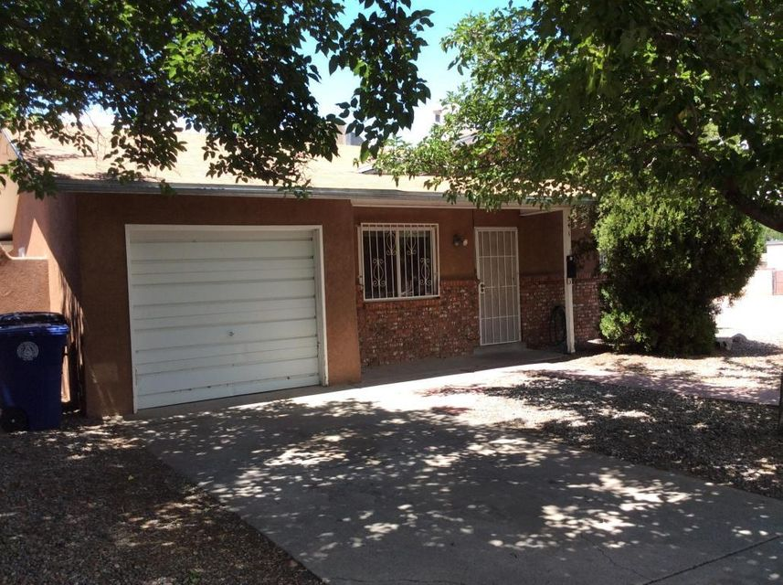 Price Reduction of $25,000.00 Inspection in document section  Bring your investors.Established home in the center of Albuquerque.  Property has large fireplace, sunroom and hobby space. Large corner lot with mature trees. beautiful wrought iron gates and windows.  New paint. but priced to sell as is.