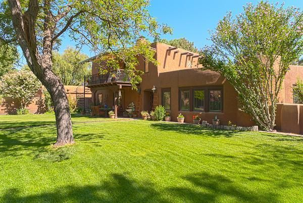 Absolutely gorgeous spectacular property.Santa Fe style Hacienda: Adobe with brick and flagstone floors. Kiva fireplaces, vigas, upscale gourmet kitchen. Huge rec room with hot tub and pool table. Gunite heated pool with 'auto' cover, 2 Koi ponds, fountain and lush grounds. Private pasture with enclosed barns - just beautiful throughout.Rare find - truly wonderful!Note:Guest house Sq. Ft. is not included in Sq. Ft. for main house. (Possible 4th bedroom, is the bedroom in the guest house)SPECIAL FINANCING AVAILABLE.