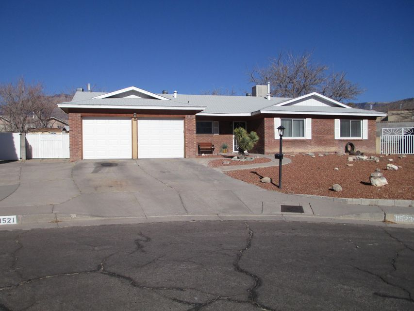 Another Price Reduction! Gorgeous home on over sized lot in Quiet Cul-De-Sac.   Large 2 way Thermo windows allow great light and Mountain Views in. Kitchen has beautiful cabinets, under cabinet lighting and granite counter tops. Eat at breakfast bar or in large dining area that boasts Travertine floors. Stainless steel appliances. Ceramic floor tile in entry, halls and baths. New tubs with ceramic tiled walls. Master bath has double sinks and lots of cabinet space. Two double closets and ceiling fan in master. Living room & Den have wood floors. Den has wood burning fireplace and access to back yard with covered patio. Patio is wired for music. Two Back yard accesses and RV pad. Large terraced back yard, two sheds, great Mt. views. Oversized two car garage. Brick front with Cedar trim.