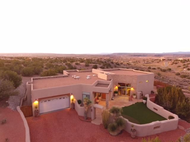 Located on a prime 1.6+ acre view lot in Placitas' Anasazi Trails subdivision, this immaculately maintained custom built home showcases amazing views of the Sandias to the southeast and the Jemez Mountains and mesas to the north and west. Meticulous attention to detail is evident throughout this home! From the hand scraped hardwood floors, spruce beamed ceiling, alder doors and wood windows to the comfort of 7 zoned radiant heat and 2 refrigerated air units, this home will not disappoint! The spacious kitchen, open to the great room, features expansive granite counters, a breakfast bar, RO filtration system, 5-burner downdraft gas cooktop and large pantry. The separate master suite with his-and-hers en-suite spa-like bath is a welcoming retreat. Please click ''more'' for additional details