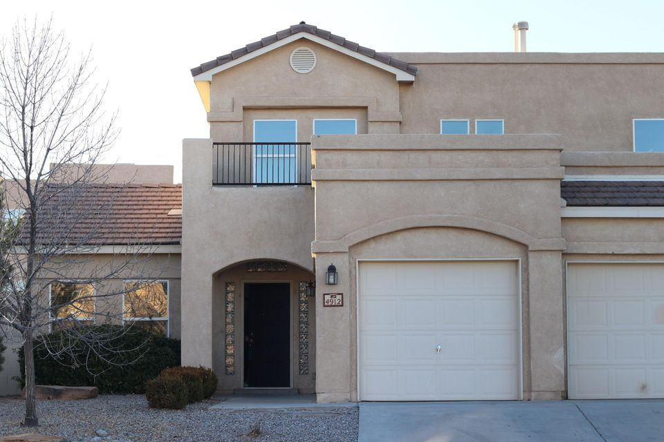 Great opportunity for just a little minor work. Come see this great light and bright home with an open floor plan.  Master and another room/office on main level, with 3 or possible 4 more upstairs. New carpet and paint. Come see this lovely home in sought after school district of Rio Rancho on a cul-de-sac.
